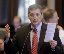 Illinois Rep. David Harris, R-Mount Prospect, argues legislation while on the House floor during session at the Illinois State Capitol Monday, Dec. 12, 2011 in Springfield, Ill. (AP Photo/Seth Perlman)