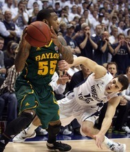 Steve Griffin  |  The Salt Lake Tribune  BYU's Matt Carlino slips down as he tries to trap Byalor's Pierre Jackson in the corner of the court during second half action of the BYU Baylor basketball game  in Provo, Utah Saturday, December 17, 2011.