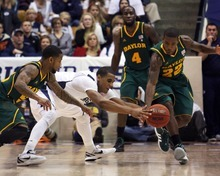 Steve Griffin  |  The Salt Lake Tribune   Baylor's  Pierre Jackson, left, and A.J. Walton strip the ball from BYU's Brandon Davies preventing him from taking another shot as time expires giving Baylor the win at the Marriott Center in Provo, Utah Saturday, December 17, 2011.