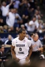 Steve Griffin  |  The Salt Lake Tribune  BYU's Brandon Davies screams with excitement as BYU pulls away from Baylor during frist half action of the BYU Baylor basketball game  in Provo, Utah Saturday, December 17, 2011.
