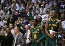 Steve Griffin  |  The Salt Lake Tribune  The Baylor bench explodes with excitement as they take the lead from the Cougars late in the second half action of the BYU Baylor basketball game  in Provo, Utah Saturday, December 17, 2011.