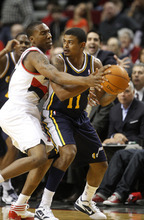 Portland Trail Blazers Nolan Smith, left, defends against Utah Jazz's Earl Watson (11) in the first quarter of an NBA preseason basketball game Monday, Dec. 19, 2011, in Portland, Ore. (AP Photo/Rick Bowmer)