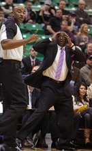 Steve Griffin  |  The Salt Lake Tribune  Utah Jazz head coach Tyrone Corbin holds his head in disbelief as his player his called for a foul during first half action of the Utah Jazz versus Portland Trail Blazers game at EnergySolutions Arena in Salt Lake City, Utah Wednesday, December 21, 2011.