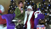 Santa Claus is interviewed by Kim McDaniel of The Salt Lake Tribune at The Gateway in Salt Lake City.