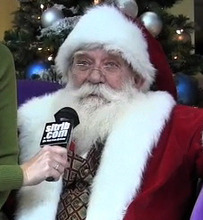 Santa Claus is interviewed by The Salt Lake Tribune at The Gateway in Salt Lake City.