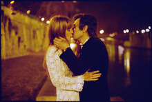Legendary French singer Serge Gainsbourg (Eric Elmosnino, right) kisses the English actress Jane Birkin (Lucy Gordon) in a scene from the biography