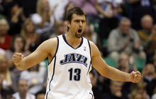 Rick Egan   |  The Salt Lake Tribune  Mehmet Okur tries to get the Jazz fired up as they stage a comeback, in the 4th quarter,  in NBA action, Utah Jazz vs. the Sacramento Kings, in Salt Lake City, Saturday, November 7, 2009