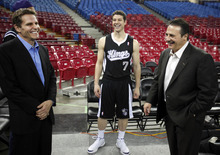 Joe Maloof, left, and brother Gavin Maloof, right, the owners of the Sacramento Kings, talk with rookie guard Jimmer Fredette, center , the team's first pick in this year's NBA draft, during the Kings' media day in Sacramento, Calif., Thursday, Dec. 15, 2011. (AP Photo/Rich Pedroncelli)