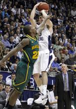 BYU guard Matt Carlino (10) shoots over Baylor guard A.J. Walton (22) during the second half of an NCAA college basketball game, Saturday, Dec. 17, 2011,in Provo, Utah. Baylor won 86-83. (AP Photo/Jim Urquhart)
