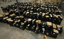 Rick Egan    The Salt Lake Tribune  Auctioneer Rob Olson said more than 600 potential bidders signed up prior to the Overstock sale to vie for 307 pallets stacked high with returned merchandise that ranged from furniture to outdoor equipment and small appliances to clothing.