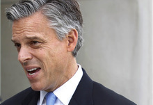 Republican presidential candidate, former Utah Governor Jon Huntsman, speaks with the media after an interview on NBC's Meet the Press outside the NBC studio in Washington on Sunday, Nov. 6,  2011. (AP Photo/Jose Luis Magana)