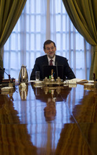 Spain's new Prime Minister Mariano Rajoy heads the new government's first cabinet meeting at the Moncloa Palace in Madrid, Friday, Dec. 23, 2011. (AP Photo/Paul White)
