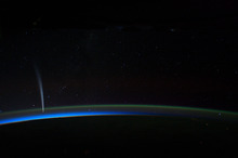 In this image provided by NASA the Comet Lovejoy is visible near Earth's horizon in this nighttime image photographed by NASA astronaut Dan Burbank, Expedition 30 commander, onboard the International Space Station on Dec. 21, 2011. (AP Photo/NASA, Dan Burbank)