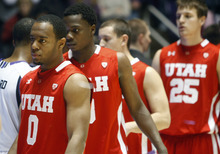 Chris Detrick  |  The Salt Lake Tribune Utah Utes guard Chris Hines (0) and Utah Utes guard Anthony Odunsi (3) walk off the court after the game at the Dee Events Center Thursday. Weber State defeated Utah 80-51.