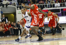 Chris Detrick  |  The Salt Lake Tribune Weber State Wildcats guard Damian Lillard (1) runs around Utah Utes guard Anthony Odunsi (3) during the second half of the game at the Dee Events Center Thursday December 22, 2011. Weber State defeated Utah 80-51.
