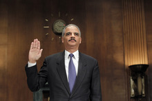 Attorney General Eric Holder is  sworn in on Capitol Hill in Washington, Tuesday, Nov. 8, 2011, prior to testifying before the Senate Judiciary Committee hearing in the arms trafficking investigation called Operation Fast and Furious. (AP Photo/J. Scott Applewhite)