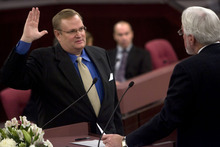 Tribune file photo Salt Lake County Auditor Gregory P. Hawkins takes the oath of office from Judge Robert HIlder at a Salt Lake County Inauguration Ceremony.
