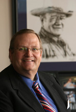 Leah Hogsten  |  The Salt Lake Tribune Greg Hawkins, Salt Lake County's new auditor, has fought to protect his office's powers.  Hawkins has a picture of John Wayne on his wall that speaks, in part, to his personality during his first months in office.