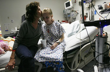 Francisco Kjolseth  |  The Salt Lake Tribune Paula Birk kisses her daughter Megan, 18, whom she calls her