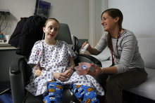 Francisco Kjolseth  |  The Salt Lake Tribune Megan Birk, 18, jokes around with occupational therapist Kristen Gallup about the actors from the