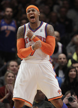 New York Knicks forward Carmelo Anthony (7) celebrates during the second half of the Knicks' 106-104 victory over the Boston Celtics in the NBA basketball season opener, in New York on Sunday, Dec. 25, 2011. Anthony scored 37 points. (AP Photo/Kathy Willens)