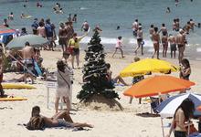 A Christmas tree stands on Bondi Beach in Sydney, Australia, Sunday, Dec. 25, 2011. (AP Photo/Rob Griffith)