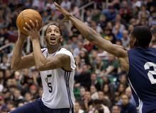 Jeremy Harmon | The Salt Lake Tribune  Utah Jazz's Devin Harris shoots past teammate Paul Carter during an NBA basketball scrimmage in Salt Lake City on Saturday.