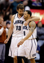 Mehmet Okur, left, will join Deron Williams in New Jersey after the Jazz traded Okur to the Nets on Thursday.  Steve C. Wilson  |  Associated Press file photo