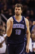 Utah Jazz's Mehmet Okur (13), of Turkey, pumps his fist after making a 3-pointer in the fourth quarter of an NBA basketball game against the Phoenix Suns Thursday, March 4, 2010, in Phoenix.  The Jazz defeated the Suns 116-108. (AP Photo/Ross D. Franklin)