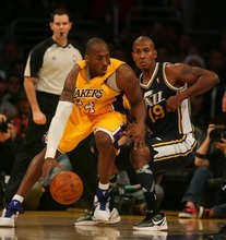 Steve Griffin     The Salt Lake Tribune  Utah's Raja Bell guards Kobe Bryant, of the Lakers, during first half action in the Jazz Lakers game at the Staples Center in  in Los Angeles, CA Tuesday, December 27, 2011.