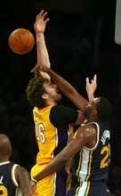 Steve Griffin     The Salt Lake Tribune  Utah's Al Jefferson blocks Pau Gasol's shot during first half action in the Jazz Lakers game at the Staples Center in  in Los Angeles, CA Tuesday, December 27, 2011.