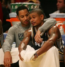 Steve Griffin  |  The Salt Lake Tribune  Utah's Devin Harris puts his arm around teammate Earl Watson after Watson came out of the game late in second half action in the Jazz Lakers game at the Staples Center in  in Los Angeles, CA Wednesday, December 28, 2011.