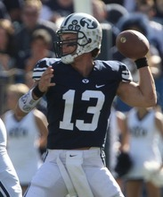 Rick Egan  | The Salt Lake Tribune   Quarterback Riley Nelson (13) throws the ball for the Cougars, in football action, BYU vs. Idaho State University football game, at Lavell Edwards Stadium, Saturday, October 22, 2011.