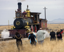 Al Hartmann  |  The Salt Lake Tribune Photographers gather for a picture of Union Pacific steam locomotive 199 as it rolls down the track to the Golden Spike National Historic Site visitor center in northwestern Utah on Wednesday, Dec. 28, 2011. Golden Spike holds its annual Winter Steam Festival on December 28-30 Folks can get up close to tour the locomotive cab, see steam demonstrations as well as take a ride on a muscle-powered handcart.