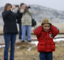 Al Hartmann  |  The Salt Lake Tribune Kurt Dahl from Plain City holds his ears but smiles as Union Pacific steam locomotive 199 rolls down the track to the Golden Spike National Historic Site visitor center in northwestern Utah  on Wednesday, Dec. 28, 2011. Golden Spike holds its annual Winter Steam Festival on December 28-30 Folks can get up close to tour the locomotive cab, see steam demonstrations as well as take a ride on a muscle powered handcart.