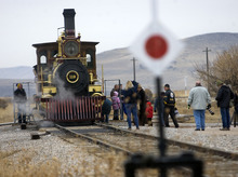 Al Hartmann  |  The Salt Lake Tribune Folks gather to see Union Pacific steam locomotive 199 at the Golden Spike National Historic Site visitor center in northwestern Utah on Wednesday, Dec. 28, 2011. Golden Spike holds its annual Winter Steam Festival on December 28-30 Folks can get up close to tour the locomotive cab, see steam demonstrations as well as take a ride on a muscle powered handcart.