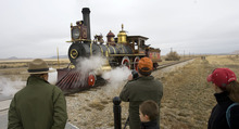 Al Hartmann  |  The Salt Lake Tribune Fols gather for a picture of Union Pacific steam locomotive 199 as it rolls down the track to the Golden Spike National Historic Site visitor center in northwestern Utah on Wednesday, Dec. 28, 2011. Golden Spike holds its annual Winter Steam Festival on December 28-30 Folks can get up close to tour the locomotive cab, see steam demonstrations as well as take a ride on a muscle powered handcart.