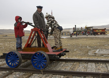 Al Hartmann  |  The Salt Lake Tribune Brighmam City cub scouts Chance Scouthsen, left,  and Logan Clark, right.  put some muscle into powering a handcart under the eye of Will Lawrence at  Golden Spike National Historic Site visitor center in northwestern Utah on Wednesday, Dec. 28, 2011. Golden Spike holds its annual Winter Steam Festival on December 28-30 Folks can get up close to tour the locomotive cab, see steam demonstrations as well as take a ride on a handcart.