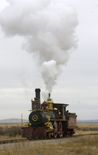 Al Hartmann  |  The Salt Lake Tribune Union Pacific steam locomotive 199 rolls down the track to the Golden Spike National Historic Site visitor center in northwestern Utah Wednesday on Wednesday, Dec. 28, 2011. Golden Spike holds its annual Winter Steam Festival on December 28-30 Folks can get up close to tour the locomotive cab, see steam demonstrations as well as take a ride on a muscle powered handcart.