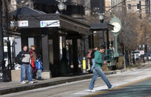 Al Hartmann  |  The Salt Lake Tribune A pedestrian jaywalks across Main Street and train tracks mid-block at the TRAX Gallivan Station in Salt Lake City. A two-hour observation of 10 stations showed scores of reckless, potentially fatal acts by passengers and drivers.