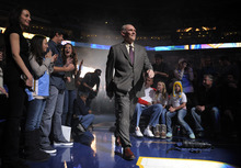 Denver Nuggets head coach George Karl walks onto the court before the Nuggets' home-opener NBA basketball game, against the Utah Jazz on Wednesday, Dec. 28, 2011, in Denver. (AP Photo/Jack Dempsey)