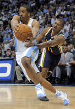 Denver Nuggets guard Andre Miller (24) drives past Utah Jazz guard Earl Watson (11) during the third quarter of an NBA basketball game Wednesday, Dec. 28, 2011, in Denver. (AP Photo/Jack Dempsey)