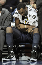 Utah Jazz center Al Jefferson (25) reacts to pain in his left knee during the third quarter of an NBA basketball game against the Denver Nuggets Wednesday, Dec. 28, 2011,  in Denver. (AP Photo/Jack Dempsey)