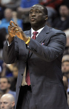 Utah Jazz coach Tyrone Corbin calls a play against the Denver Nuggets during the first quarter of an NBA basketball game Wednesday, Dec. 28, 2011, in Denver. (AP Photo/Jack Dempsey)