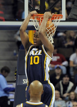 Utah Jazz guard Alec Burks (10) reverse dunks against the Denver Nuggets during the fourth quarter of an NBA basketball game Wednesday, Dec. 28, 2011, in Denver. (AP Photo/Jack Dempsey)