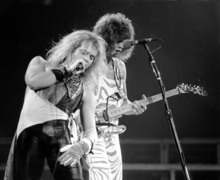 FILE-   In this Oct. 19, 1982 file photo, lead singer David Lee Roth, left, and lead guitarist  Eddie Van Halen of Van Halen perform during a concert at The Spectrum in Philadelphia. Van Halen will tour in 2012. The rock band has posted a video on its website announcing that the first tickets will go on sale Jan. 10, but no other details.   (AP Photo/File)