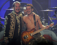 FILE-  In this Friday, Nov. 23, 2007 file photo, David Lee Roth, left and Eddie Van Halen of Van Halen perform during a concert in Glendale, Ariz.  Van Halen will tour in 2012. The rock band has posted a video on its website announcing that the first tickets will go on sale Jan. 10, but no other details.  (AP Photo/Rick Scuteri, File)