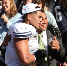 Rick Egan    The Salt Lake Tribune   Brigham Young Cougars linebacker Uona Kaveinga (4) celebrate the 24-21 win over Tulsa in the Armed Forces Bowl, with Elder Elder Ulukivaiola, from the Dallas Texas Mission, Friday, December 30, 2011
