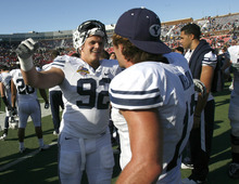 Rick Egan    The Salt Lake Tribune   Brigham Young Cougars defensive end Graham Rowley (92) hugs Riley Nelson (13) as they celebrate the 24-21 win over Tulsa in the Armed Forces Bowl, in Dallas, Texas, Friday, December 30, 2011