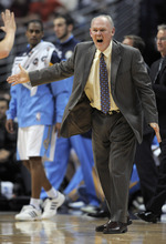Denver Nuggets coach George Karl reacts to a call during the second quarter of an NBA basketball game against the Utah Jazz on Wednesday, Dec. 28, 2011, in Denver. (AP Photo/Jack Dempsey)